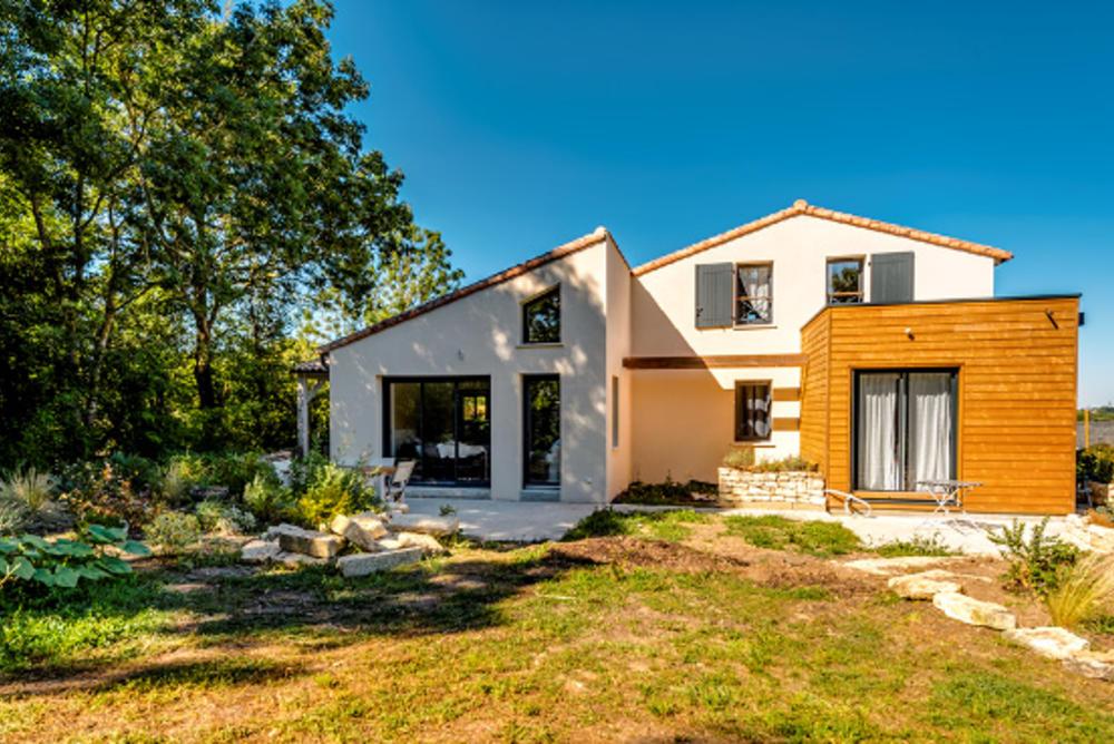 Nos r alisations de maisons ossature bois delrieu construction bois for Construction bois 49